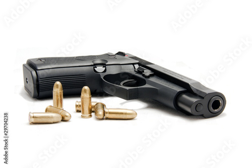 Photo  firearm with ammunition in white background