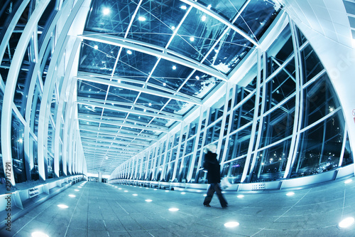 Fotografie, Obraz  People walking in modern blue walkway interior
