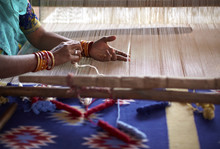 Woman Hand Weaving A Carpet Wi...