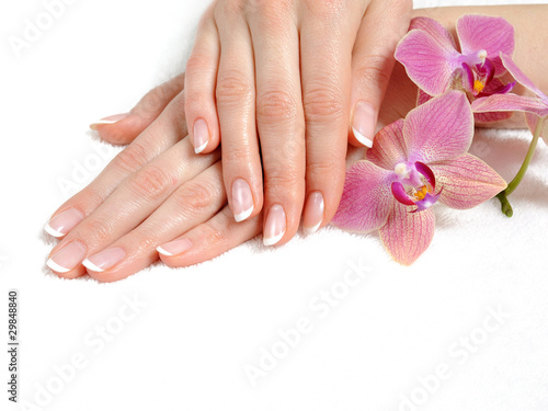 Staande foto Manicure Beautiful hand with perfect nail french manicure and purple orch
