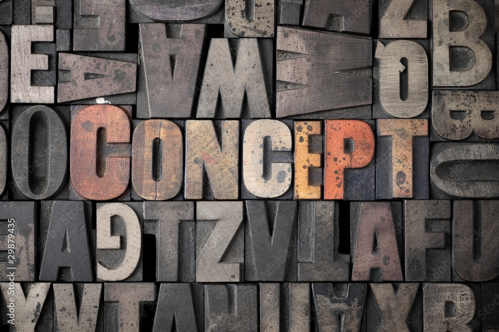 The word 'Concept' spelled out in very old letterpress blocks.
