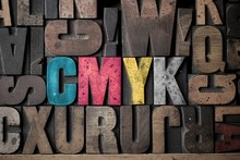 The Letters 'CMYK' Spelled Out...