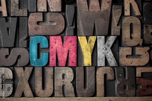 The letters 'CMYK' spelled out in very old letterpress blocks. Slika na platnu