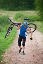 Cyclist Carrying Bicycle