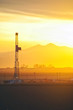 Sunset on an oilrig and the Rocky Mountains