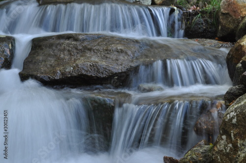 Cold peaceful waterfall in a New England stream © Betsy Baranski