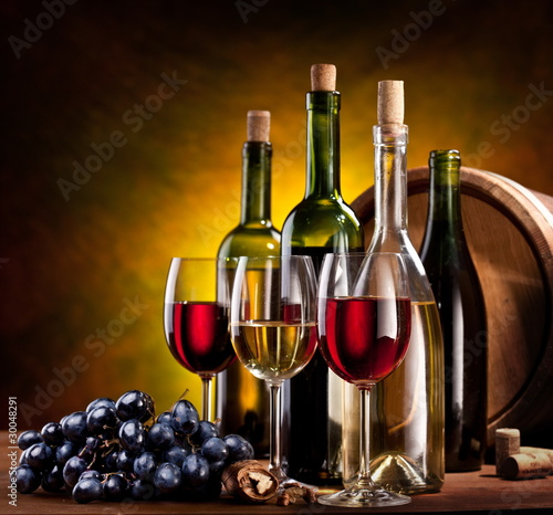 Papiers peints Vin Still life with wine bottles, glasses and oak barrels.