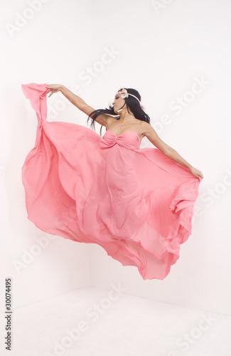 Garden Poster Brunette in a pink long dress