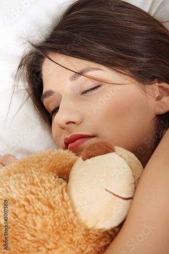 Fototapeta Girl in bed with teddy bear obraz na płótnie