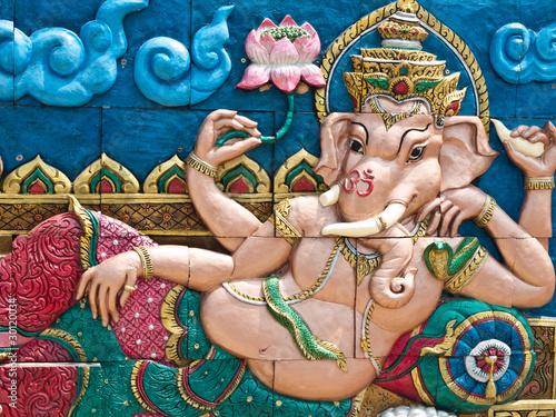 Photo  Golden Hindu God Ganesh on wall