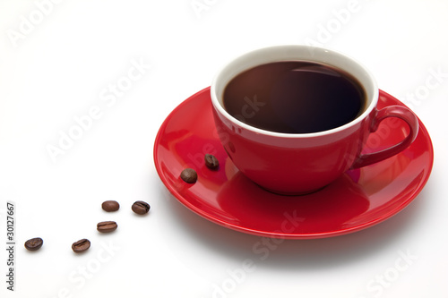 Fotografie, Obraz  Red coffee cup and grain on white background