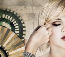 Hairdresser Making An Intricate Hair Do