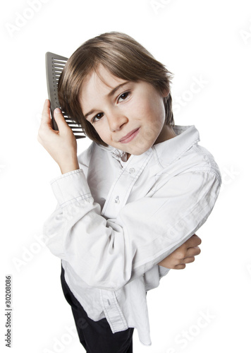 Obraz na plátně garçon enfant look coiffure peigne coiffer beau physique