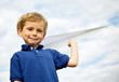 Boy Holding a Paper Airplane