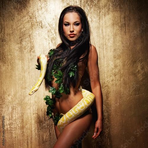 Fotografie, Obraz  Attractive brunette woman with python