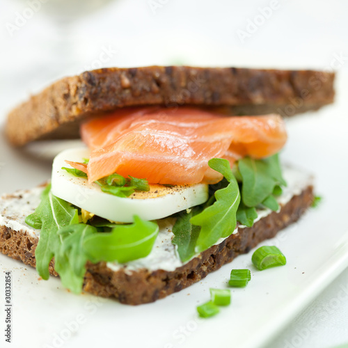 Closeup of sandwich with smoked salmon,egg and rocket