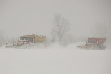 Snow Plows In A Blizzard