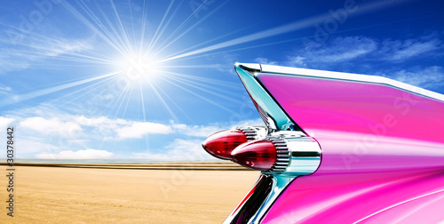 Pink cadillac on beach Canvas Print