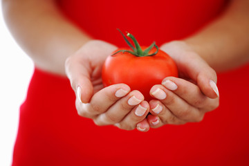 tomato in woman hands