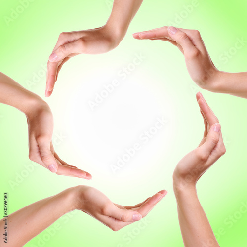 Fototapety, obrazy: Woman's hands made circle on green background