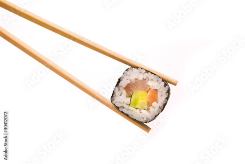 Fotografía  Sushi with chopsticks isolated on a white background