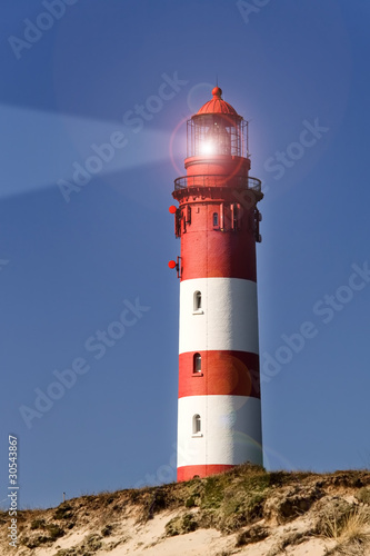 Foto-Leinwand - Leuchtturm in der Dämmerung