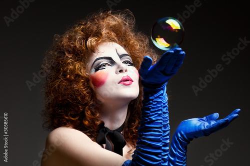 Fotografie, Tablou  woman mime with soap bubbles.