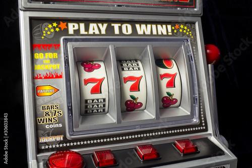 Foto  slot machine with three times seven