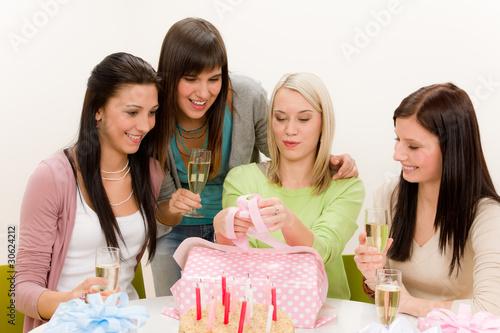 Fotografia, Obraz  Birthday party - woman unwrap present, celebrating