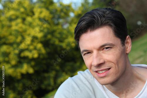 Fototapety, obrazy: Portrait of handsome smiling man