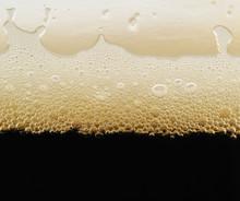 Foam Of Dark Beer With Bubbles