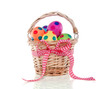 colorful easter eggs painted with dots in a wicker basket with r