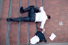 Businessman Falling Down The S...