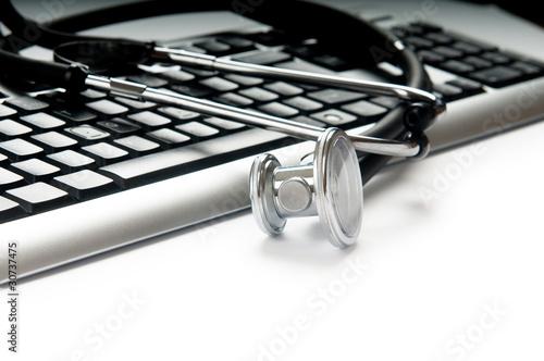 Poster de jardin Metal Stethoscope and keyboard illustrating concept of digital securit