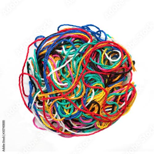 Fototapeta  ball of multicolored woolen threads on white