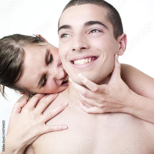 jeunes femme et homme s'embrassant dans le cou Canvas Print