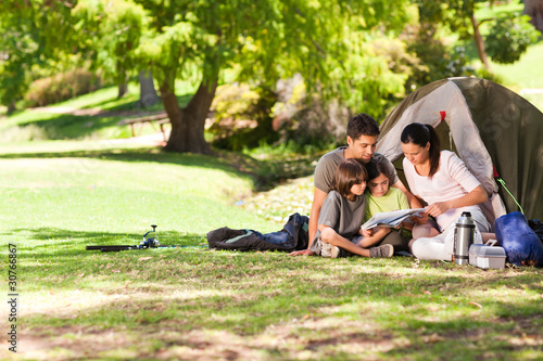 Fotobehang Kamperen Joyful family camping in the park