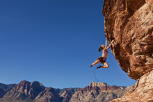Female Rock Climber Clinging T...