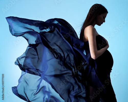 Fototapeta  Beauty and glamour of  pregnant woman in blue chiffon