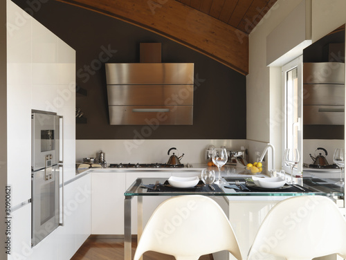 cucina moderna con tavolo snack - Buy this stock photo and ...