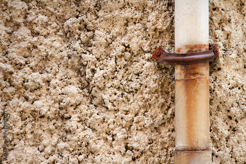 Wall plaster old old water pipes - Buy this stock photo and