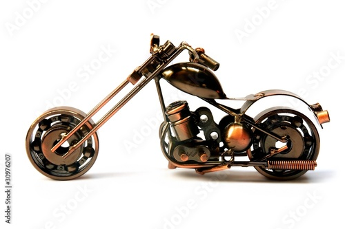 Photo Cute metallic motorbike souvenir isolated over white