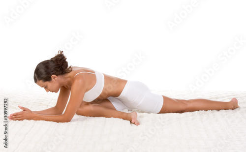 yoga pose - female in sport clothes performing exercise Canvas-taulu