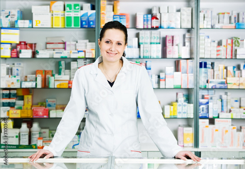 Foto op Aluminium Apotheek Pharmacy chemist woman in drugstore