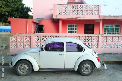 Caribbean pink house tropical retro car facade