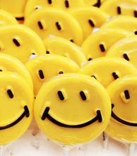 Smiley Emotions On Yellow Lollipops