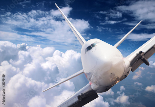 Big jet plane above clouds - 31091449