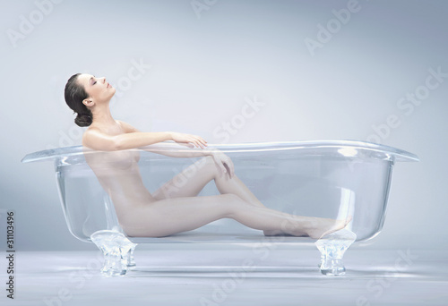 Vászonkép brunette beauty takes a bath