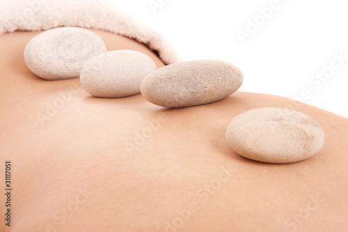 Foto op Plexiglas Stenen in het Zand girl in a spa with zen stones