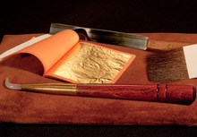 A Booklet Of Pure Gold Leaf For Gilding With Craftsman's Tools